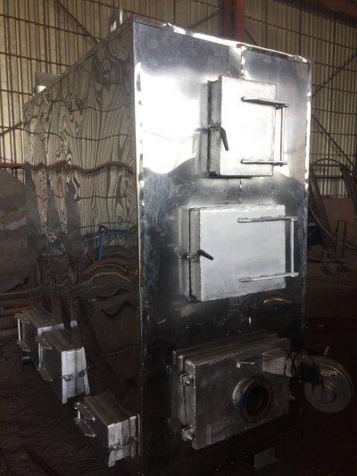 Твердотопливный масленый котёл с автоматической подачей топлива
