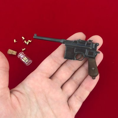 Продам Действующую миниатюрную модель пистолета Маузер К96 под 2мм патрон